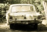 An old Ford Falcon in a shady driveway