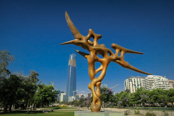 Sculpture in Parque de las Esculturas, with the almost  complete Santiago Tower in the background.